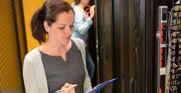43324718 - female engineer in datacenter by network servers